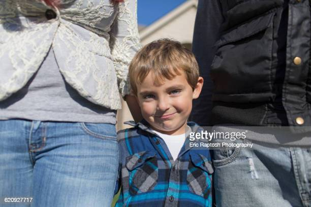 Caucasian parents and son smiling outdoors