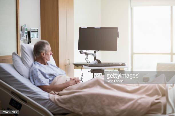 caucasian patient sitting in hospital bed - hospital ward stock pictures, royalty-free photos & images