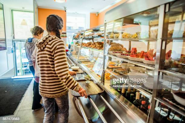 Caucasian people purchasing food at cafeteria