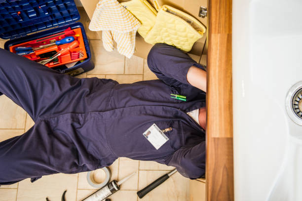 caucasian plumber working under sink picture id672156457?k=6&m=672156457&s=612x612&w=0&h= z1B