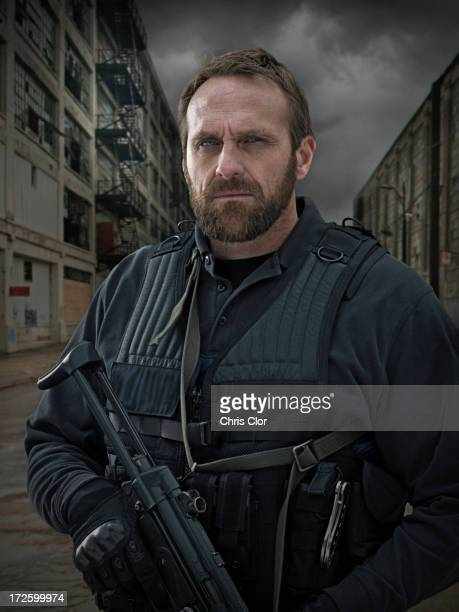 caucasian policeman on city street - task force stock pictures, royalty-free photos & images