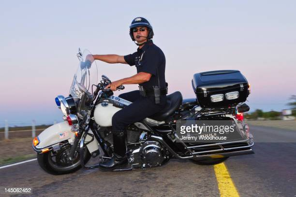 caucasian policeman riding on motorcycle - jeremy woodhouse stock pictures, royalty-free photos & images