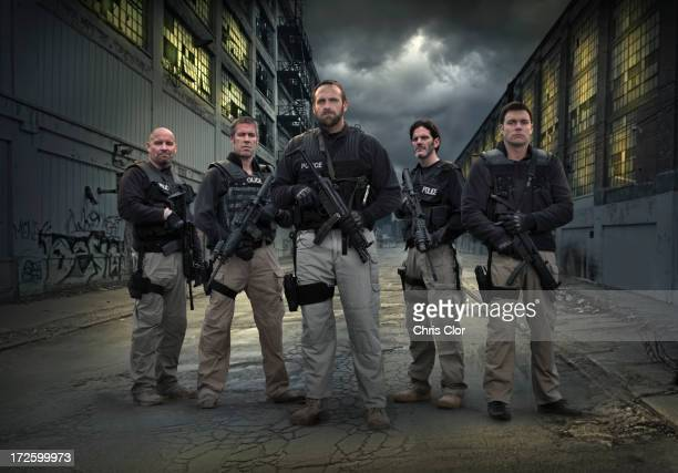 caucasian policemen on city street - task force stock pictures, royalty-free photos & images