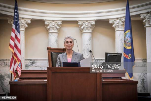 caucasian politician giving speech in capitol building - white house podium stock pictures, royalty-free photos & images