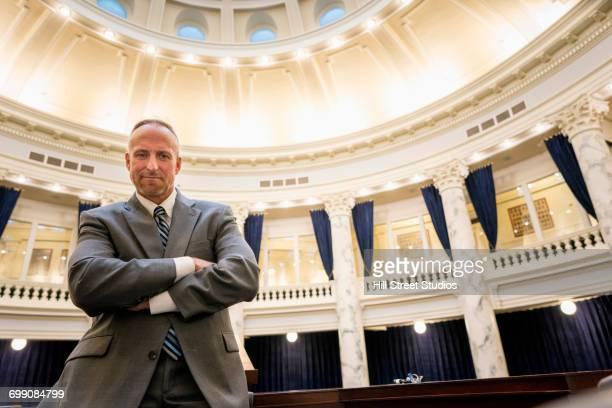 caucasian politician posing in rotunda - tensed idaho stock photos and pictures