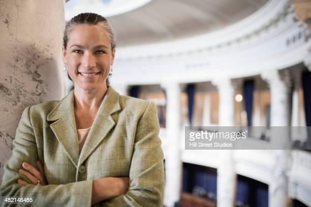 Caucasian politician smiling in government building