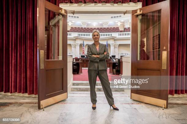 Caucasian politician standing in capitol building
