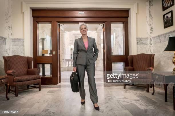 caucasian politician standing in doorway - eingangshalle gebäudeteil stock-fotos und bilder