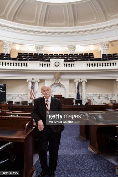 caucasian politician standing in government building - rotunda stock pictures, royalty-free photos & images