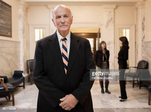 caucasian politician standing in government building - politician stock pictures, royalty-free photos & images
