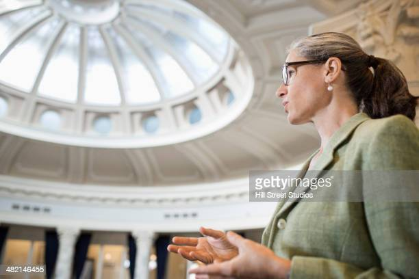 caucasian politician talking in government building - government stock pictures, royalty-free photos & images