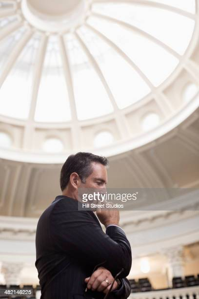 caucasian politician thinking in government building - tensed idaho stock photos and pictures