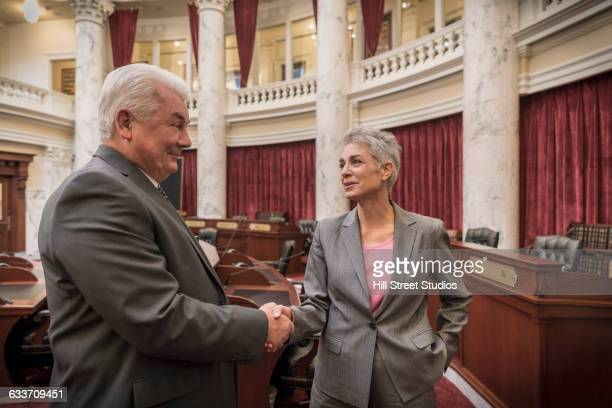 caucasian politicians shaking hands in capitol building - congressman stock pictures, royalty-free photos & images