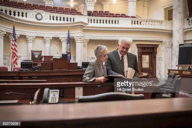 caucasian politicians talking in capitol building - member of congress stock pictures, royalty-free photos & images