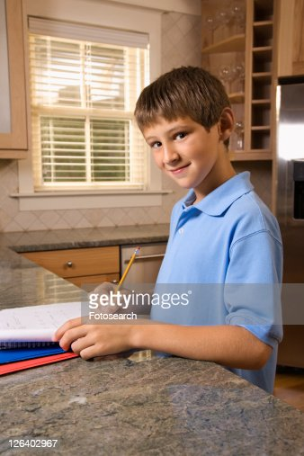 Teenage Caucasian Girl15 Years Old Sitting Outdoors: Caucasian Preteen Boy Doing Homework At Kitchen Counter