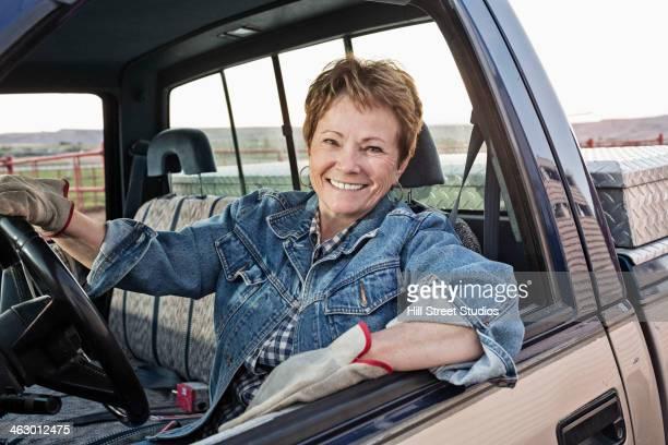 Caucasian rancher driving truck
