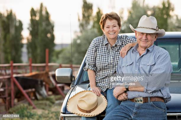 caucasian ranchers sitting against truck - rancher stock pictures, royalty-free photos & images
