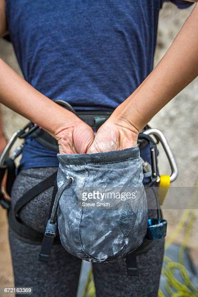 caucasian rock climber chalking hands - chalk rock stock pictures, royalty-free photos & images