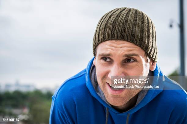 Caucasian runner resting outdoors