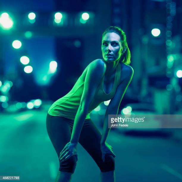 Caucasian runner standing on city street
