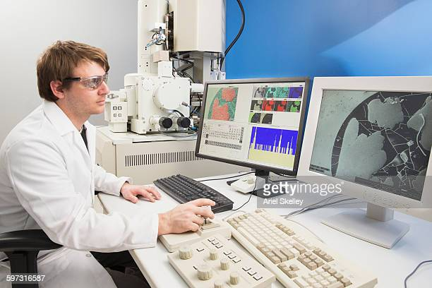 Caucasian scientist using computer in laboratory