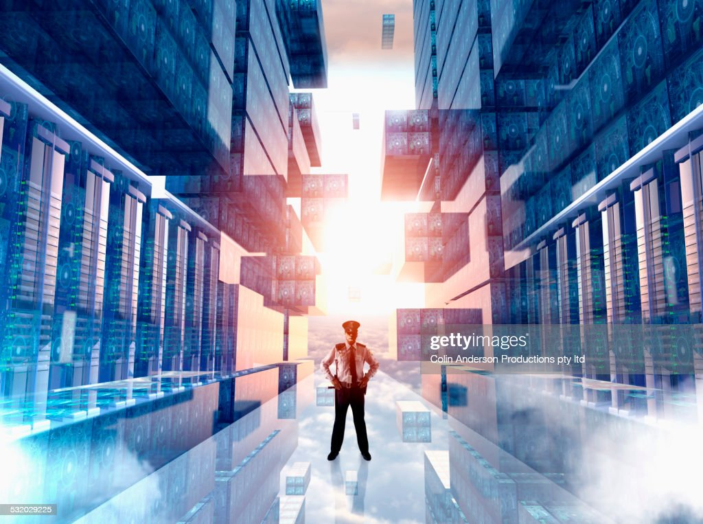 Caucasian security officer guarding virtual server room : Stock Photo