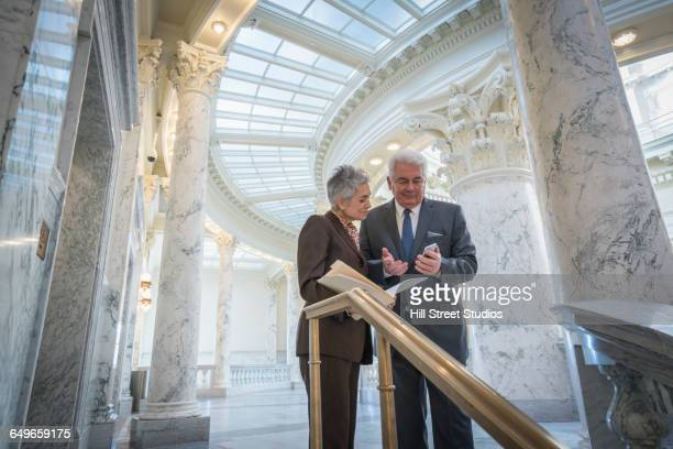 caucasian senator talking in capitol - government stock pictures, royalty-free photos & images