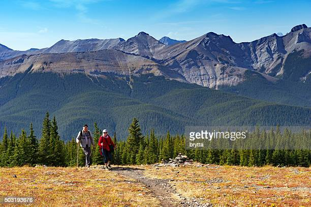 caucasian senior couple hiking in the mountains - kananaskis country stock pictures, royalty-free photos & images