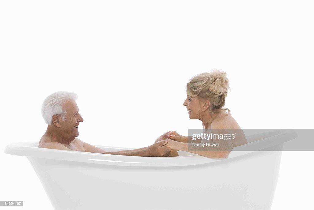 Caucasian Senior Couple In Bath Tub Smiling : Stock Photo