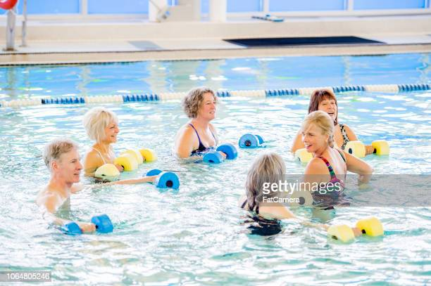 caucasian seniors exercise in pool - community centre stock pictures, royalty-free photos & images