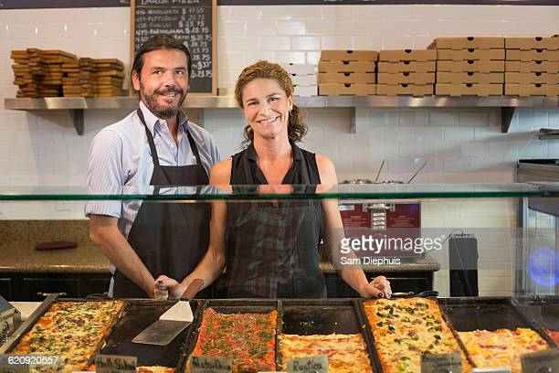 caucasian servers smiling in cafe - pizzeria stock photos and pictures