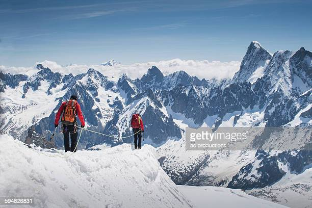 caucasian skiers walking on mountaintop, mont blanc, chamonix, france - monte bianco foto e immagini stock