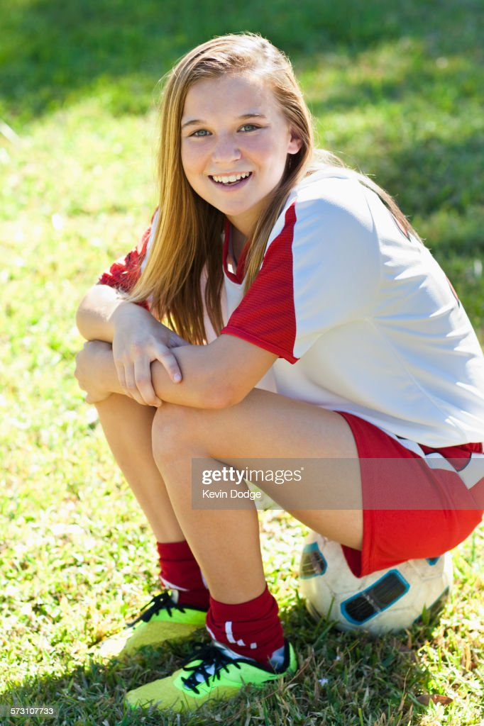 Caucasian Soccer Player Sitting On Ball In Grass Stock Photo  Getty Images-1744