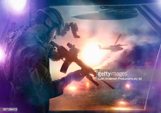 caucasian soldier aiming gun from helicopter - technology trade war stock pictures, royalty-free photos & images