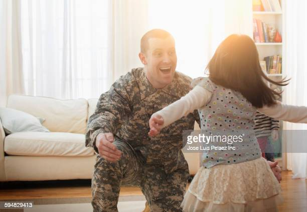 Caucasian soldier greeting daughter