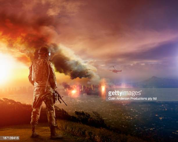 caucasian soldier overlooking combat zone - war stock pictures, royalty-free photos & images