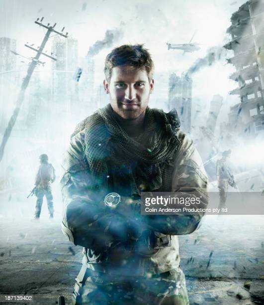 caucasian soldier standing in combat zone - army soldier stock photos and pictures