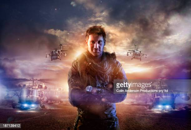 caucasian soldier standing in combat zone - hero stock photos and pictures