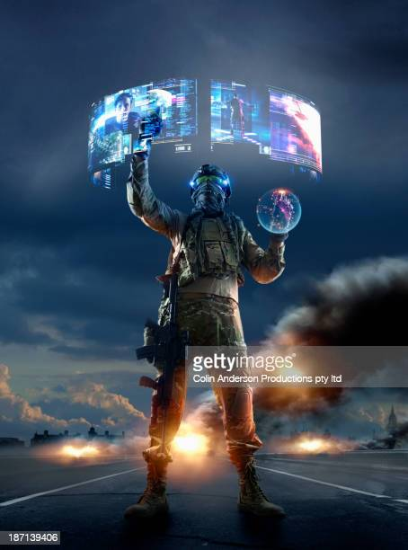 Caucasian soldier using holographs in combat zone