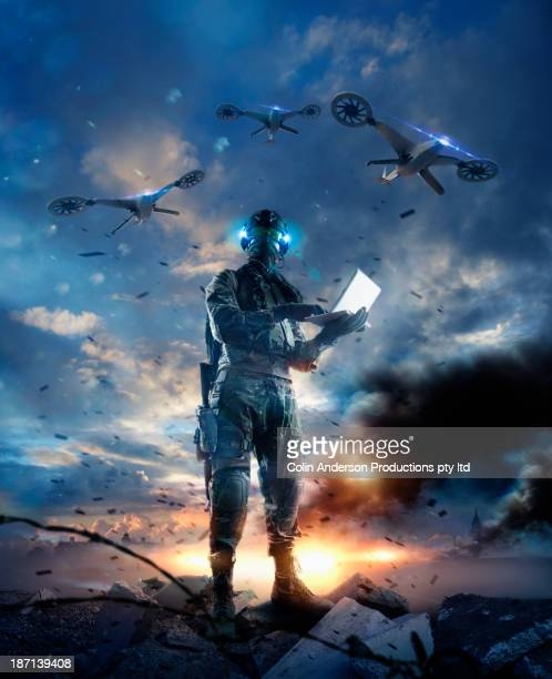 caucasian soldier using laptop in combat zone - military drones stock pictures, royalty-free photos & images