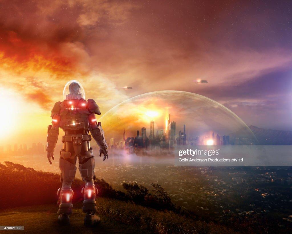 Caucasian soldier wearing glowing armor : Foto de stock