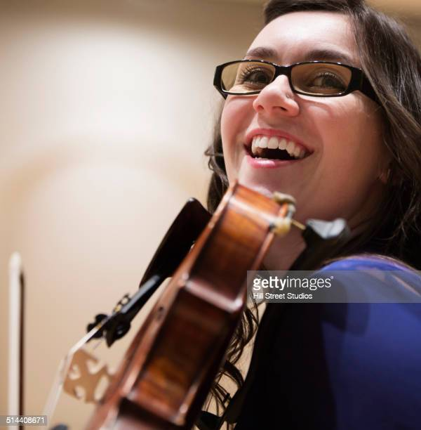 caucasian student playing violin - soloist stock photos and pictures
