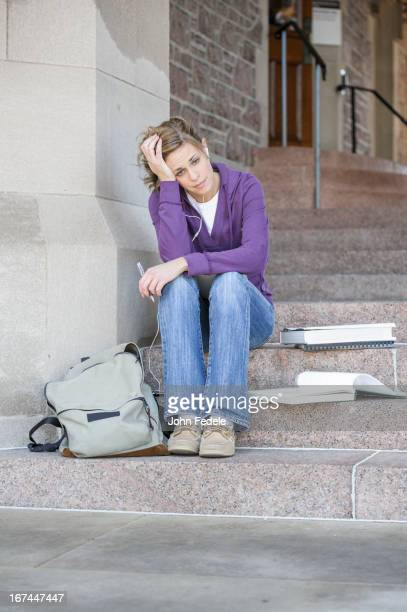 Caucasian student sitting on campus