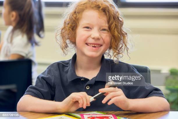 Caucasian student smiling in classroom