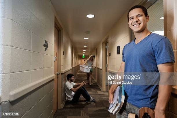 caucasian student smiling in dorm hallway - caldwell idaho stock pictures, royalty-free photos & images