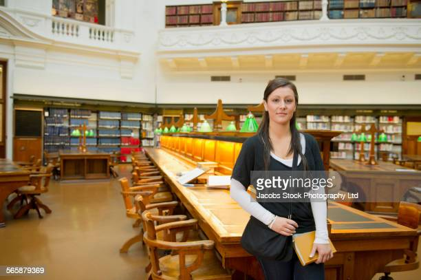 Caucasian student smiling in library