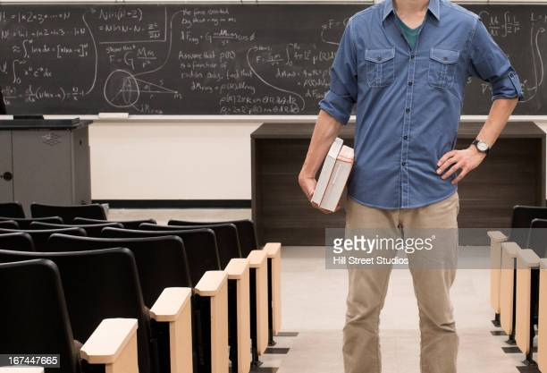 caucasian student standing in classroom - caldwell idaho stock pictures, royalty-free photos & images