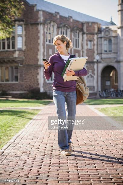 Caucasian student walking on campus