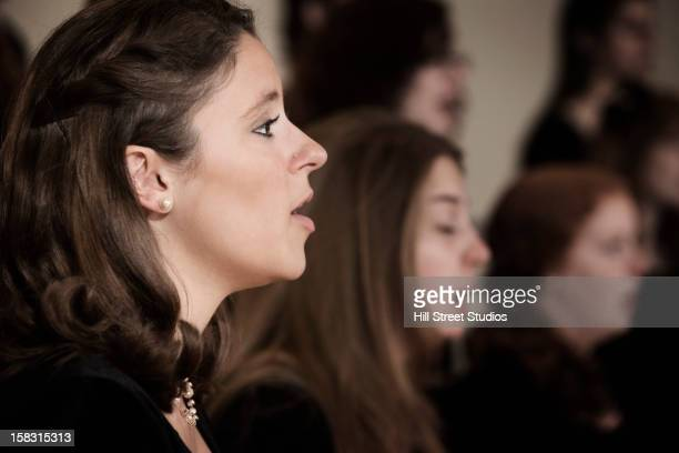 caucasian students singing in choir - choir stock pictures, royalty-free photos & images