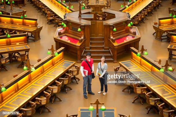 Caucasian students standing in library